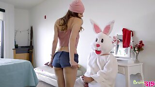 A man dressed in an Easter bunny kit fucks two bad girls