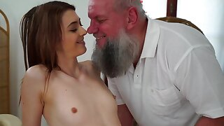 Teen cutie is stroking and sucking old guy on the kneading table